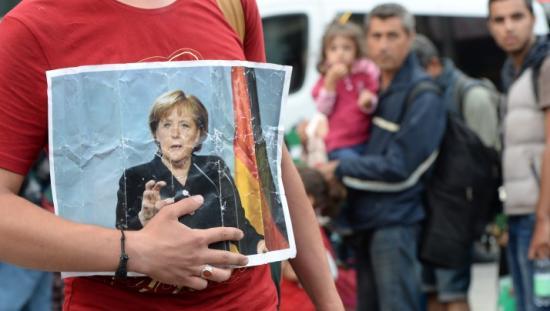 Merkel: ellentétes az európai szellemiséggel a menekültek befogadásának elutasítása